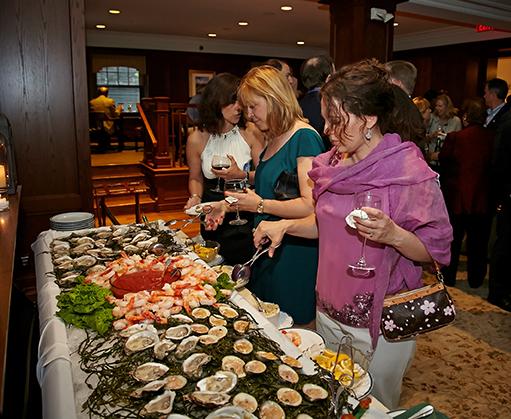 Guests enjoying raw bar